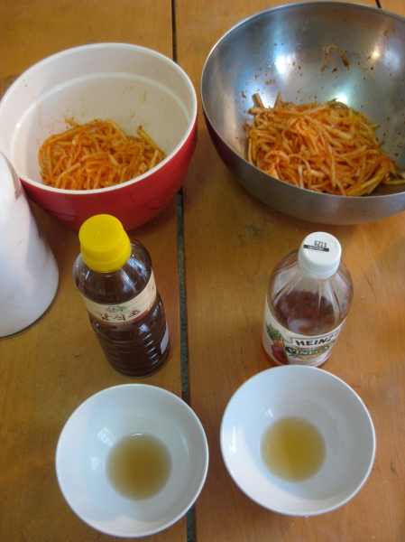 Experimenting with persimmon vinegar v. apple cider vinegar for spicy radish strips.